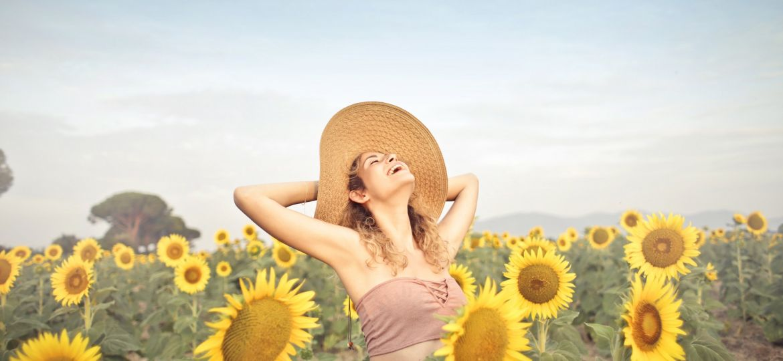 woman-standing-on-sunflower-field-3764579